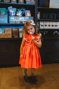 orange dress with pom pom trim