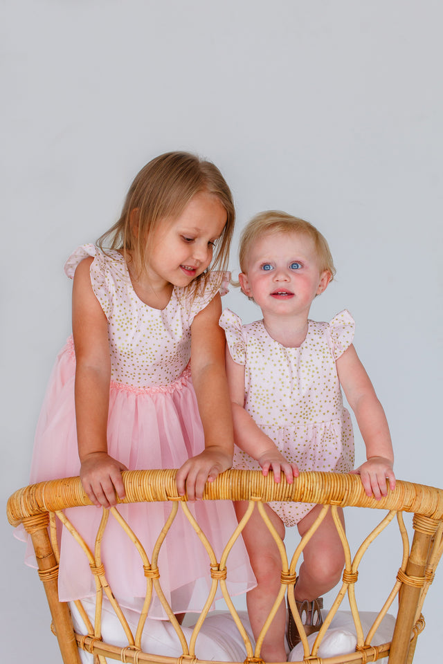 pink and gold birthday party sister outfits