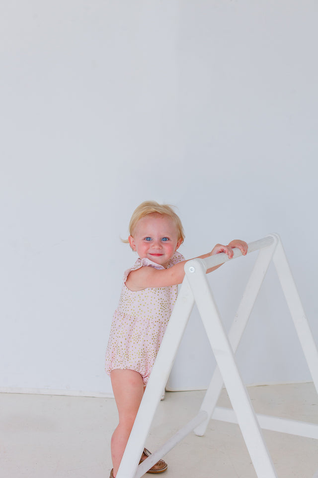 pink and gold star bubble romper