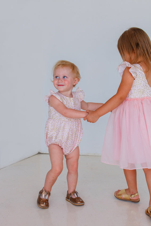 pink and gold stars romper