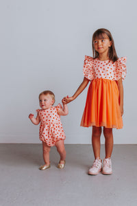 little girl's floral bubble romper orange