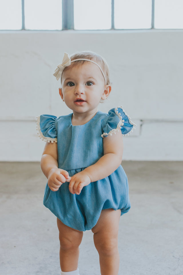 Infant Girl's Denim Chambray Romper with Pom Pom Trim