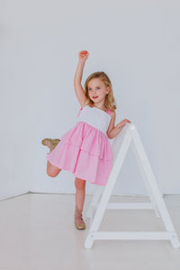pink and white little girls dress