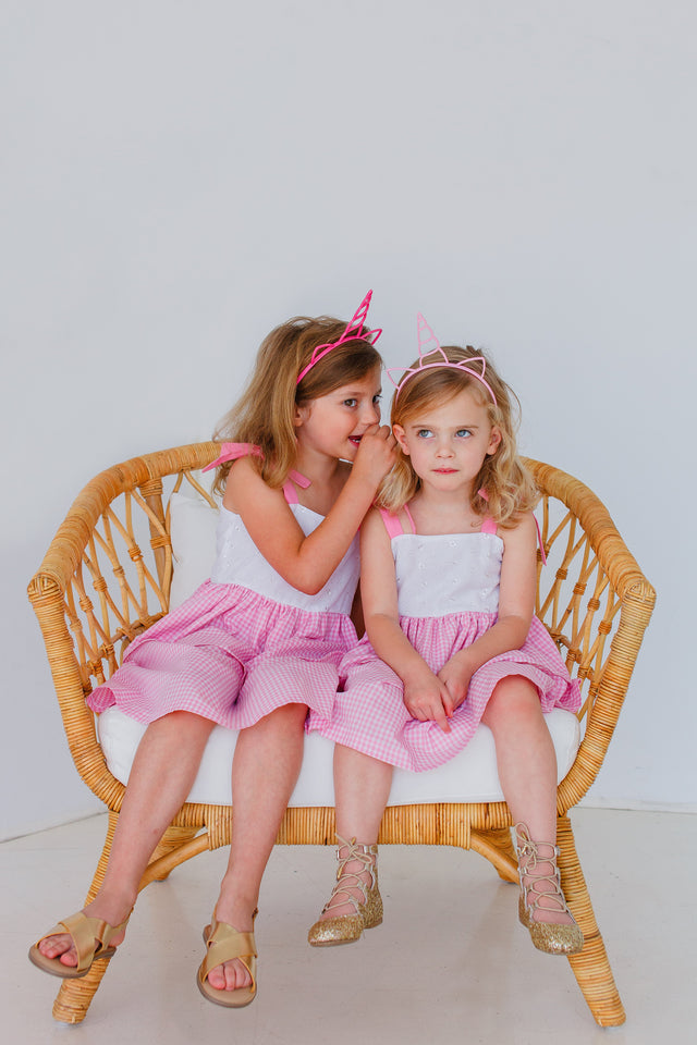 little girls matching pink and white dressing