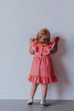 little girls boho coral gingham pom pom dress