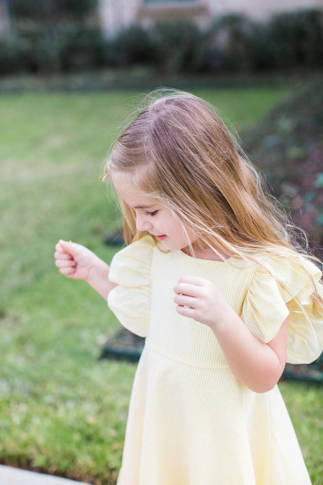 yellow ruffle dress