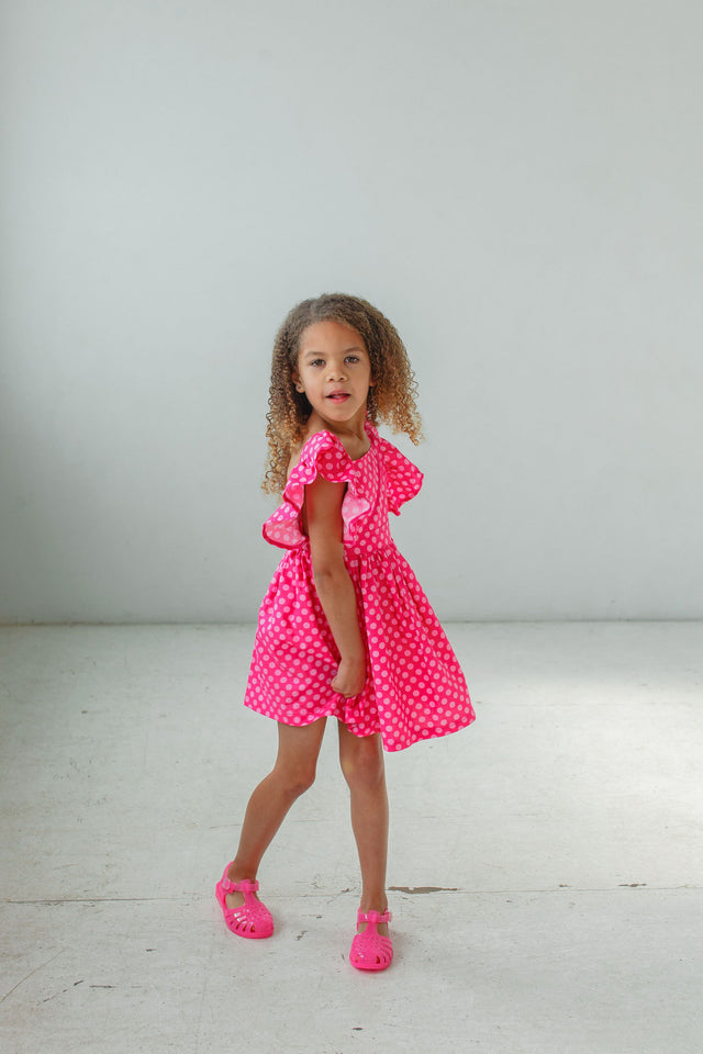 little girls pink polka dot pinafore style dress