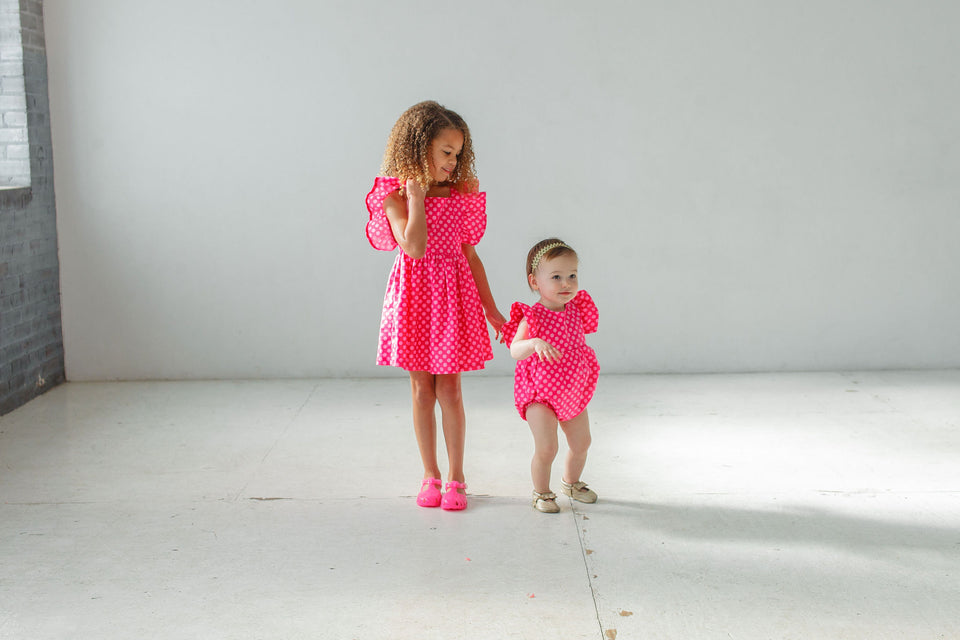 little girls matching pink polka dot outfits