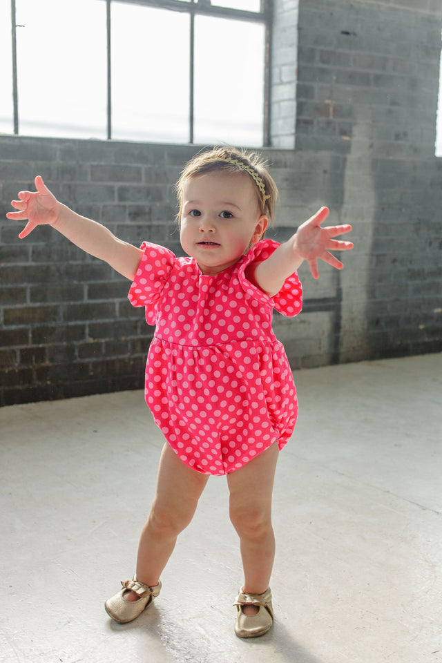 pink polka dot bubble romper first birthday cake smash