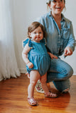 chambray bubble romper with pom pom trim