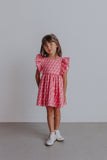 little girl's pink ruffle dress