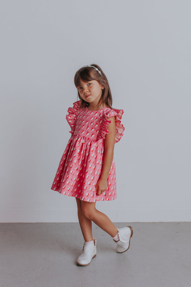 little girl's pink and white raindrop dress