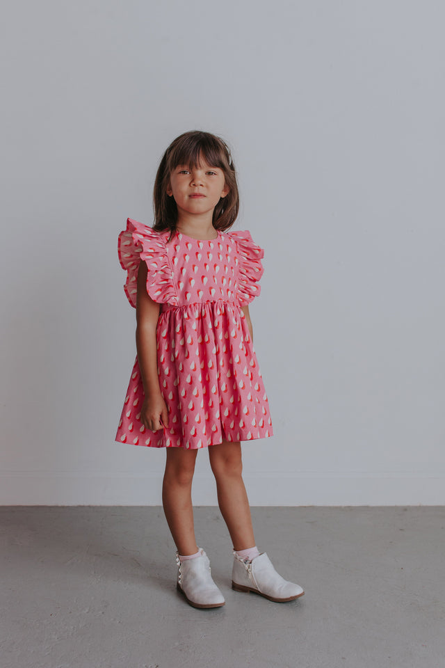 girl's pink and white ruffle dress
