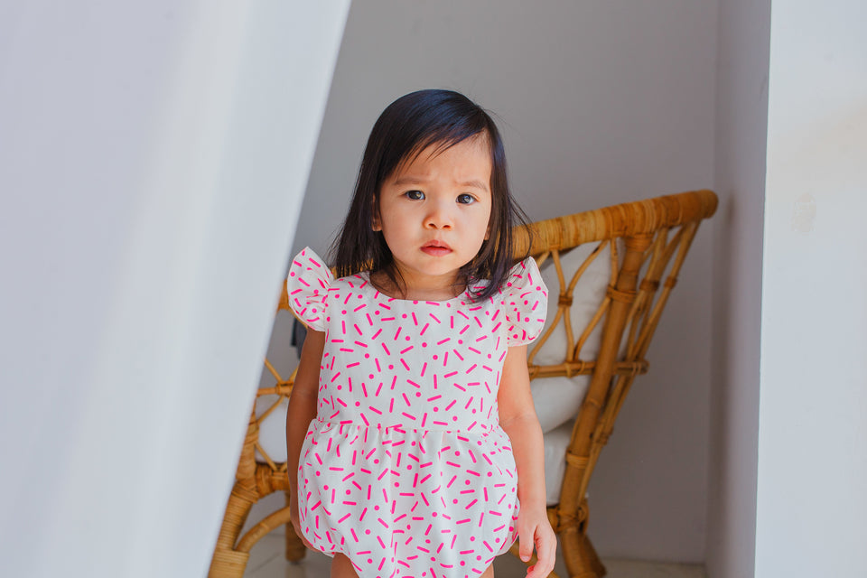 pink confetti bubble romper for baby