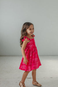 little girl's bright pink tie dye Spring dress