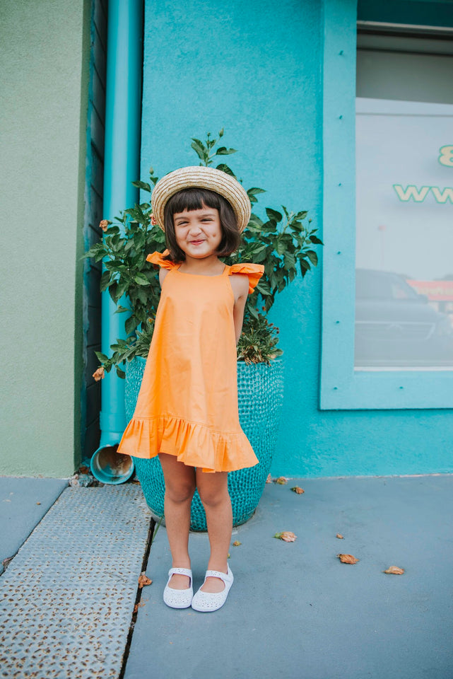 Orange ruffle pom pom dress