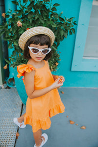 Little girls orange pom pom dress