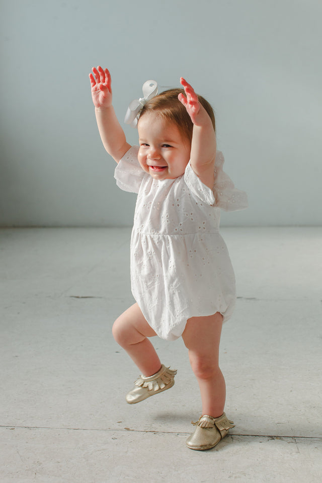 baby girl's white eyelet bubble romper