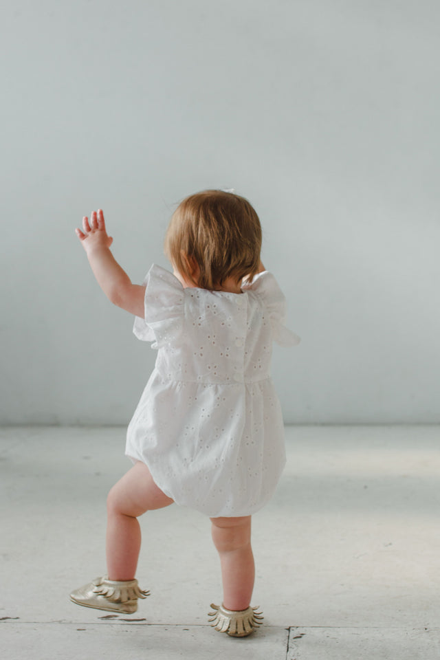 baby girl's white first birthday outfit