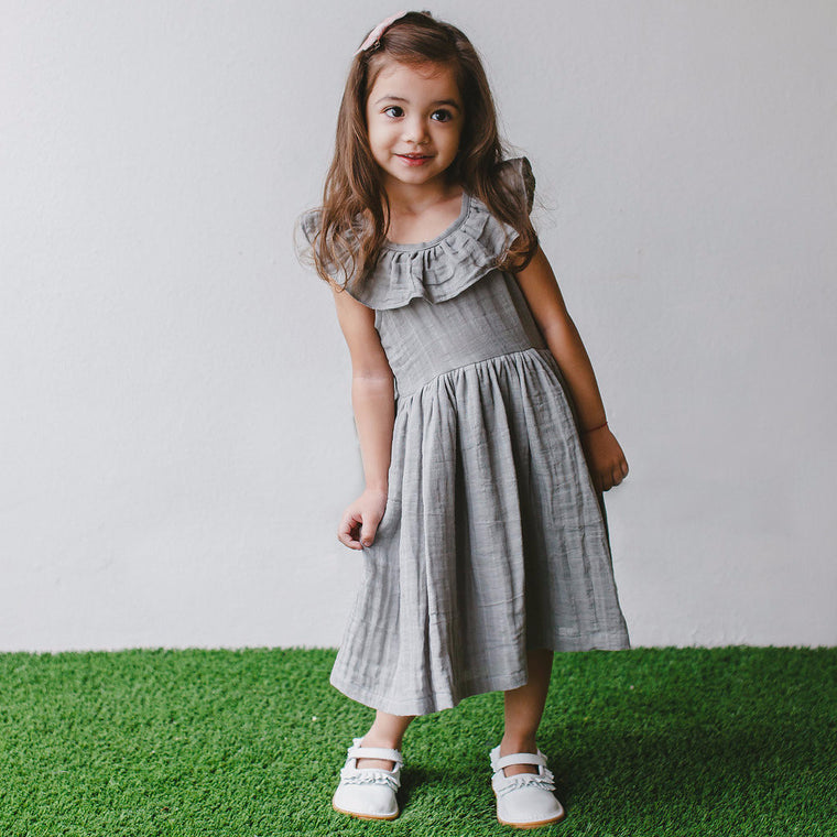dress with ruffles around neck