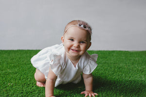 white bubble romper baby