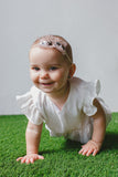 white romper for baby