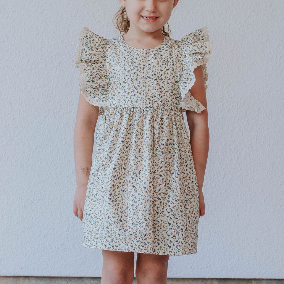 little girl's beige and blue vintage inspired pinafore ruffle dress