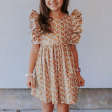 little girl's beige orange and gold calico floral pinafore style dress