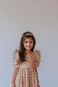 little girl's beige orange and gold calico floral pinafore style dress with crochet lace trim