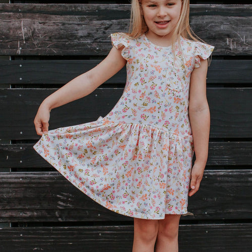 Little Girl's Ivory Floral Jersey Three Pocket Dress