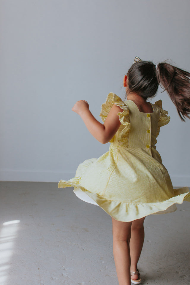 little girls yellow Belle dress