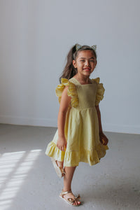 little girls yellow ruffled dress