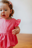 pink first birthday photoshoot romper