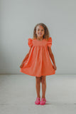 little girl's orange sundress