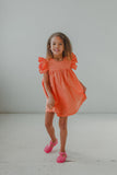 little girl's orange polka dot sun dress