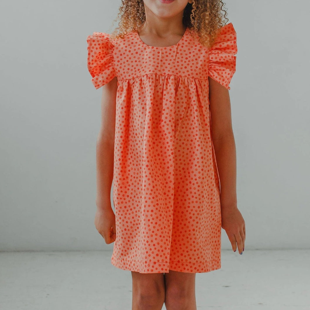 little girl's orange ruffle dress