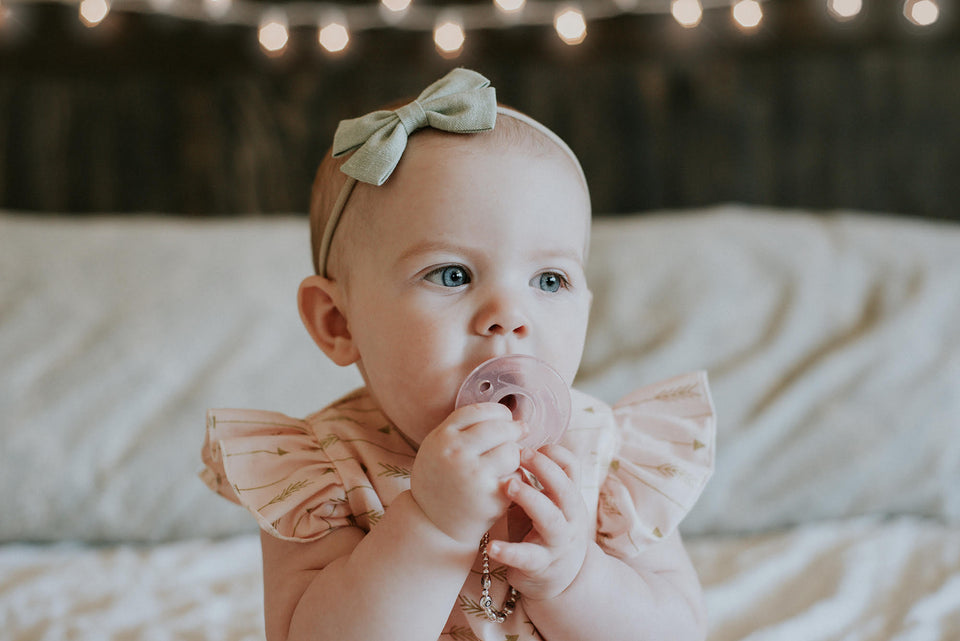 baby pink and gold bubble romper