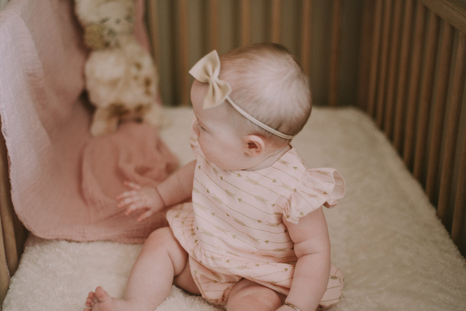 pink and gold arrow romper