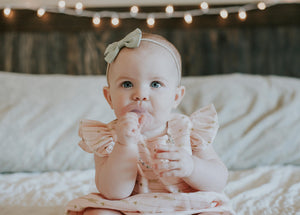 pink and gold boho romper for baby