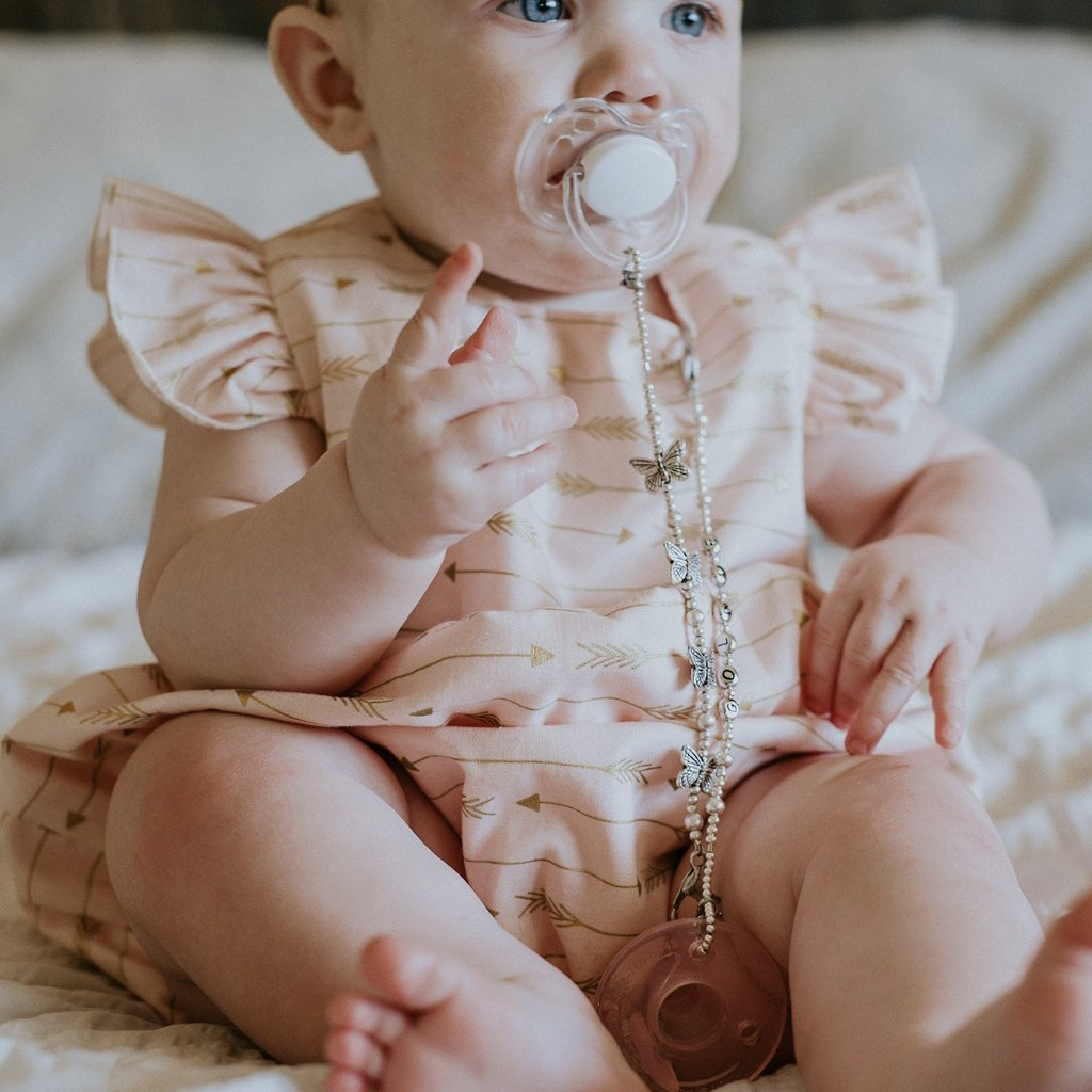 pink and gold bubble romper
