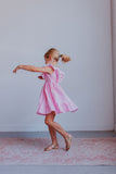 pink twirly dress