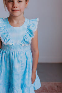 little girls gingham blue pom pom dress