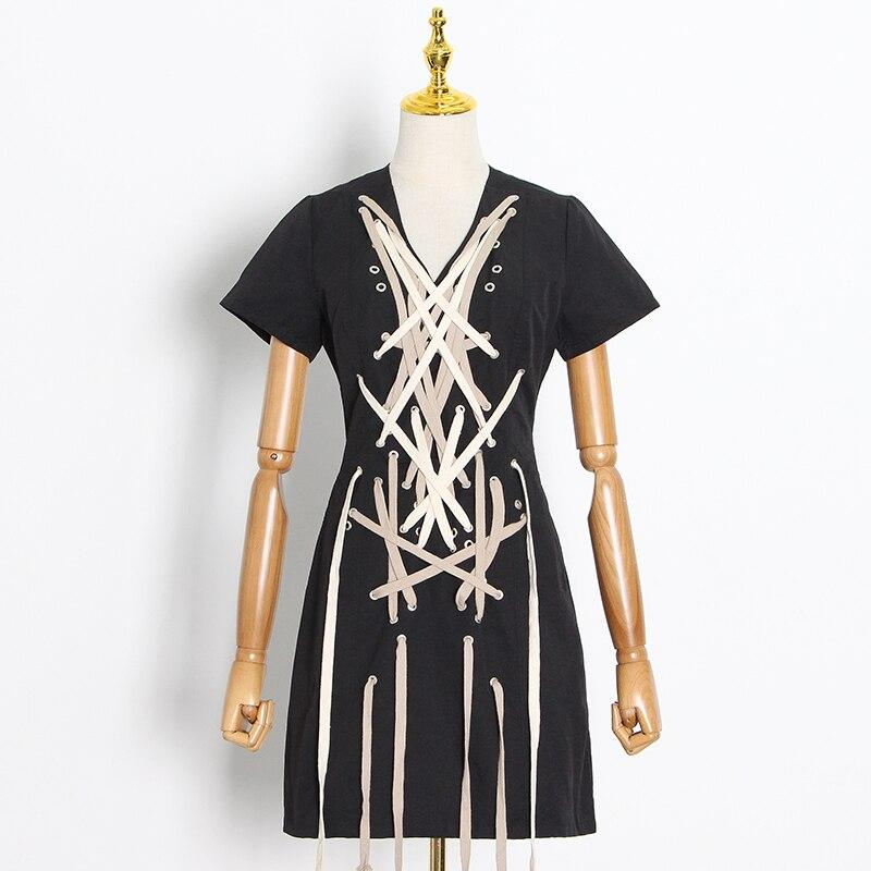 Laced up black mini dress