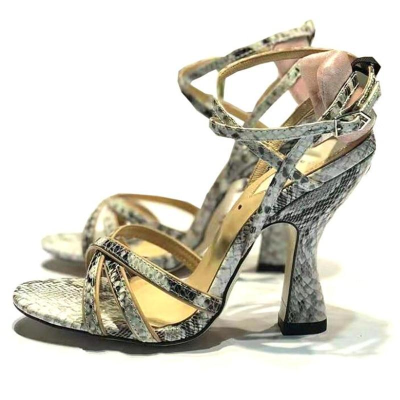 Serpent print cross-tied sandals