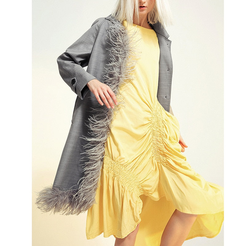 Asymmetric feathered trench
