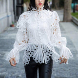 Eyelet turtleneck flare sleeved blouse in colors