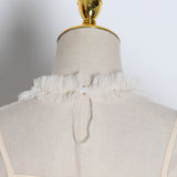 Ruffled mesh O-Neck blouse in colors