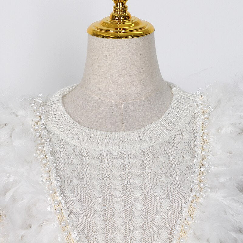 Lace knit sweater with feathers