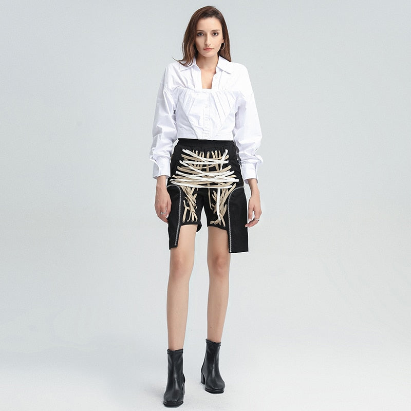 Extravagant high-waist laced up pants