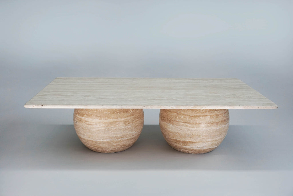 Ciel Sombre Coffee Table. Solid carved spherical travertine base showcases the incredible layered textures and tones stone. Honed travertine top offers a sense of contrasting weightlessness.